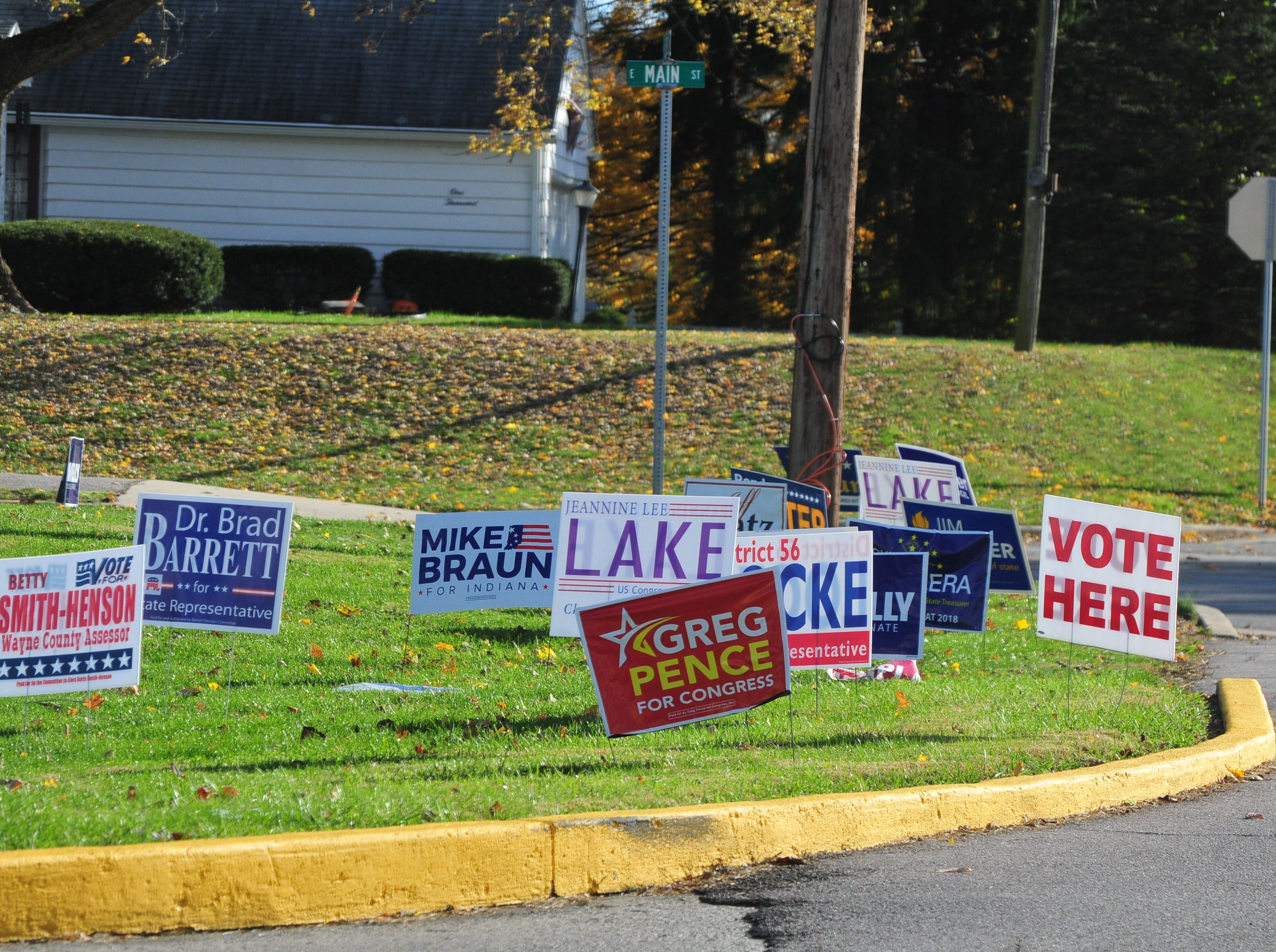 Signs for various candidates sit outside the Golay Center in Cambridge City on Tuesday, Nov. 6, 2018.