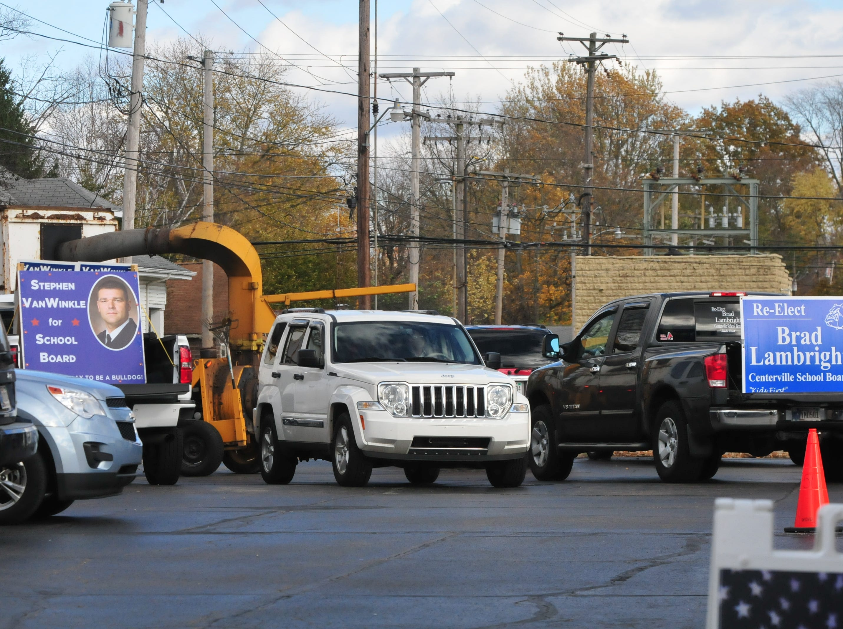 Signs for dueling school board candidates sit in the back of trucks in the parking lot outside the Centerville Christian Church Family Center on Election Day, Nov. 6, 2018.