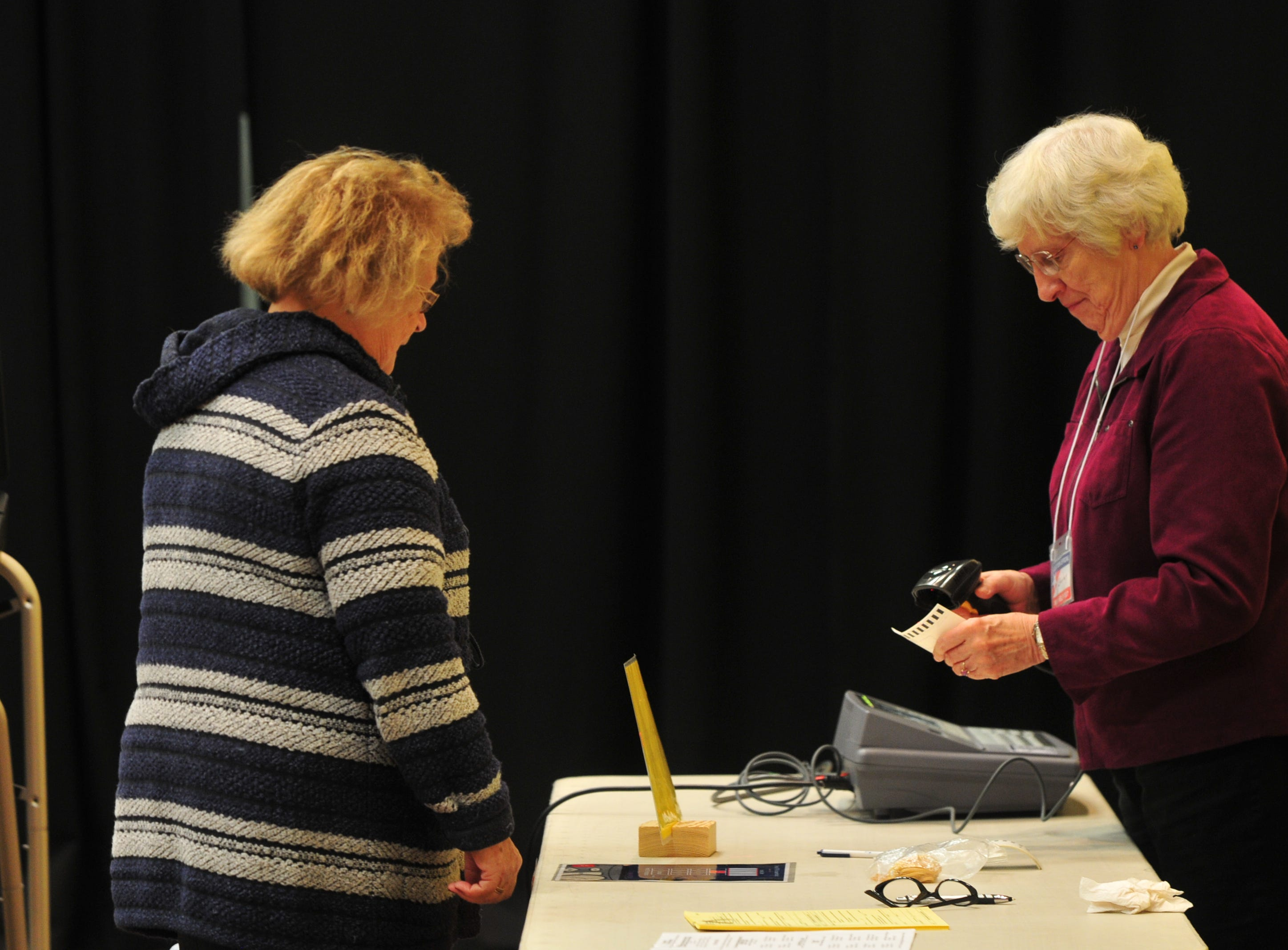 Voters cast their ballots at the Fountain City Wesleyan Church vote center on Election Day, Nov. 6, 2018.