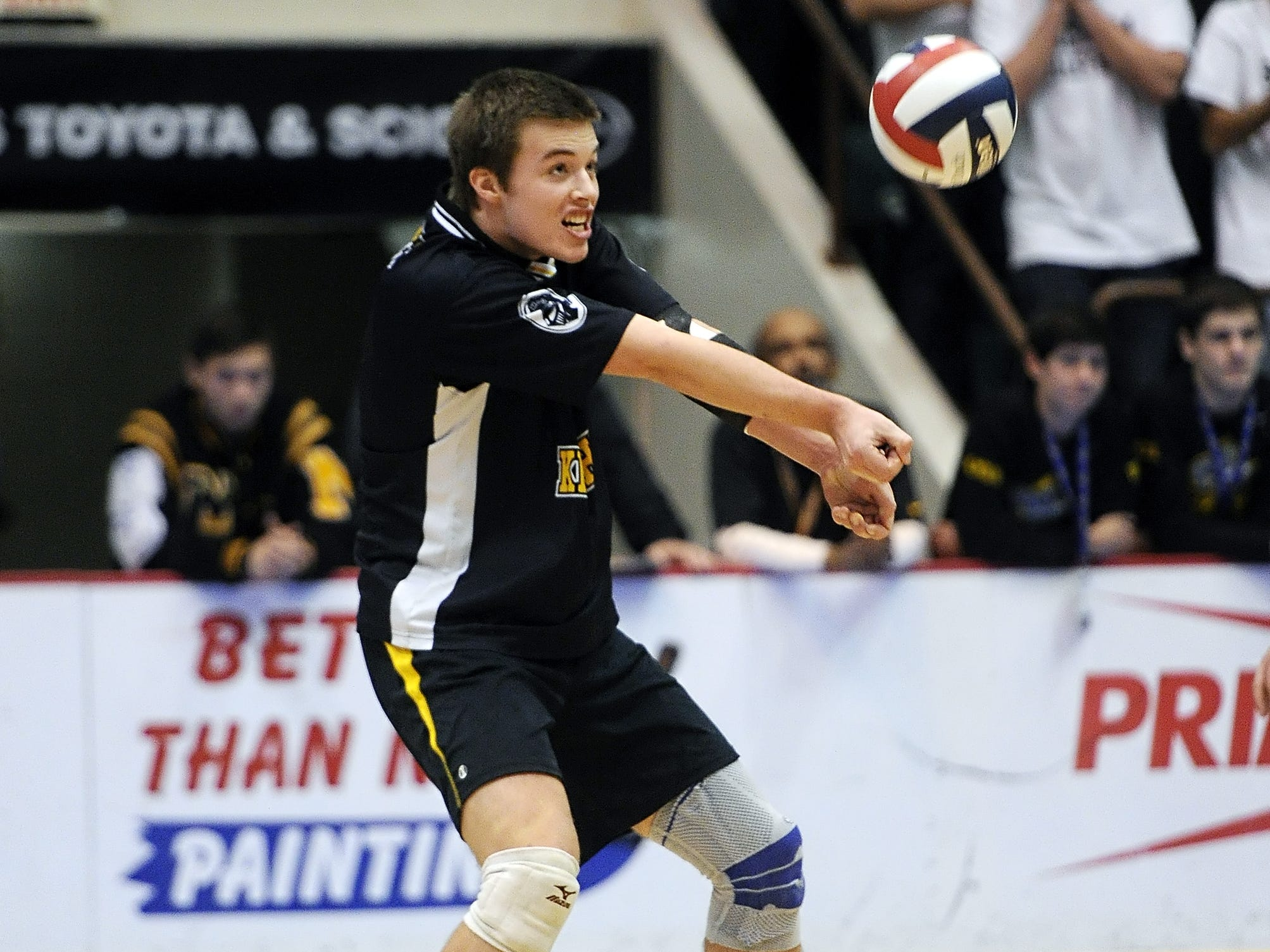 McQuaid's T. Riley Dolan receives serve against Sachem North during the Division 1 final at the NYSPHSAA Boy's Volleyball Championships held at the Glens Falls Civic Center on Friday, November 11, 2014.  McQuaid lost the final to Sachem North-XI in four games (22-25, 22-25, 25-21, 18-25).