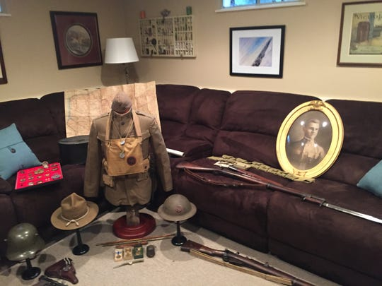"John ""Jack"" Gamrod, a native Rochesterian fought in many of the big battles in WWI and returned home and ran a paint business for years. His grandson, Kevin Kinny of Pittsford, has collected Gamrod's WWI uniform, his medals, his letters home. Kinney augmented the collection with some of the guns and other equipment his grandfather would have used."