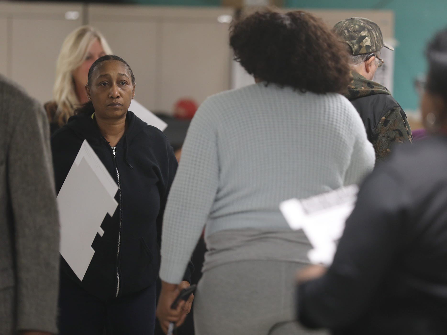 Sheila Parson of Rochester gets ready to step forward to cast her vote at Edgerton Center.
