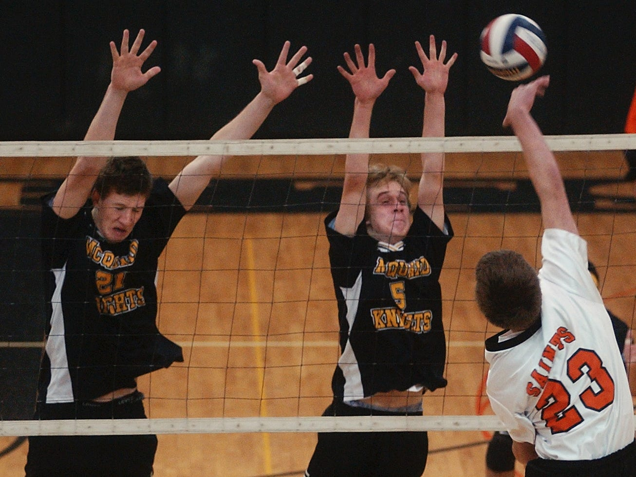McQuaid's Jack Marchand and Ryan Barney set up a block during a 2006 match against Churchville-Chili.