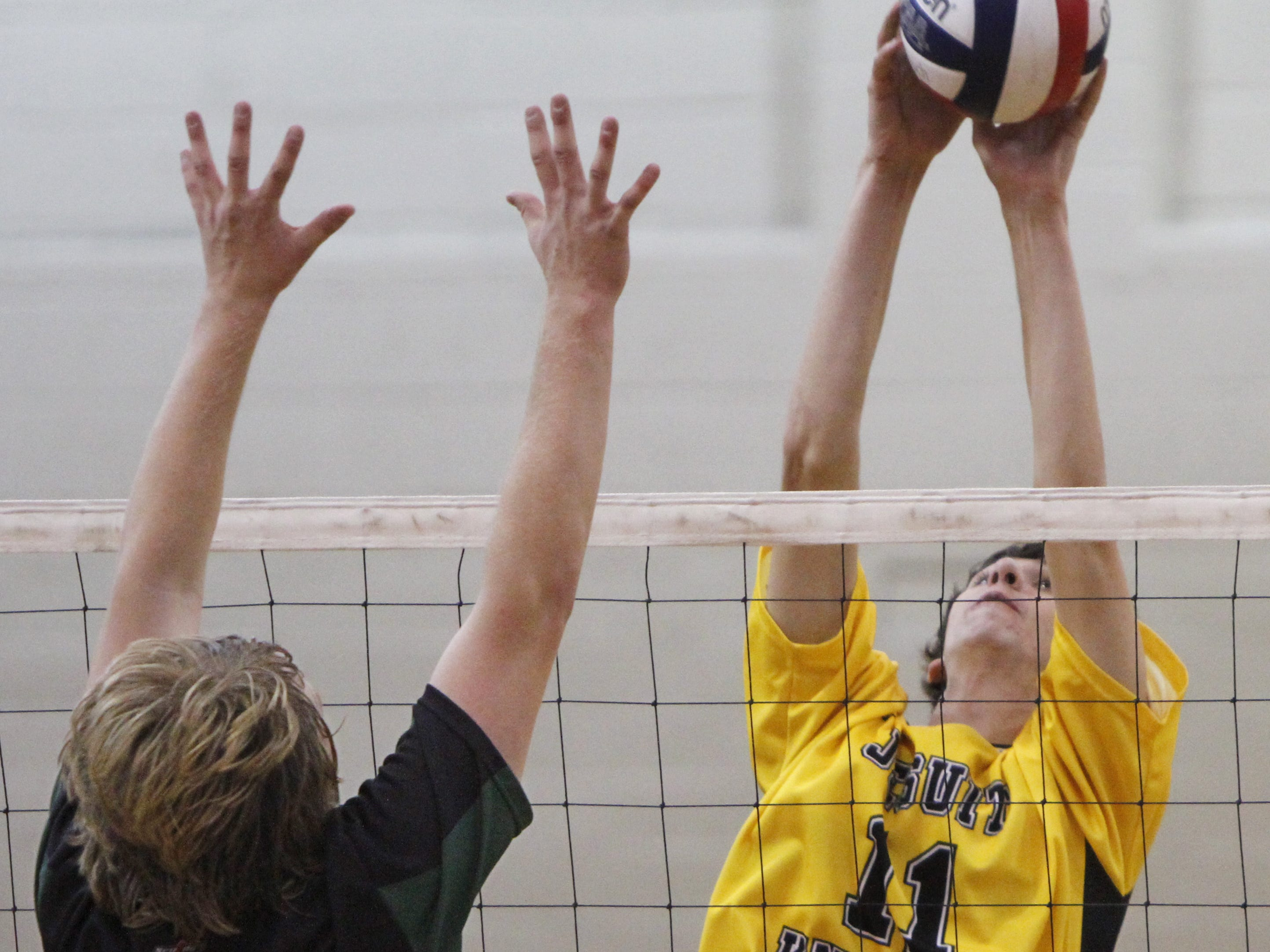 McQuaid's Michael McAlpin, right, pushes a shot past Rush Henrietta's Jesse Neely for a point during their match Monday, Oct. 15, 2012 at McQuaid Jesuit in Brighton.  McQuaid won the match in straight sets 3-0.