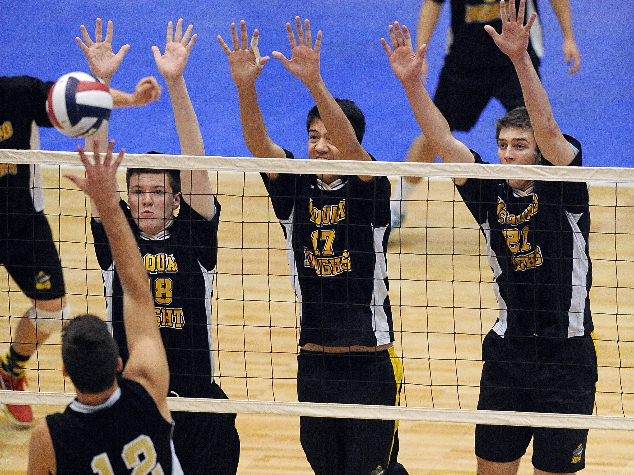 McQuaid's Erik Johnsson, right, Joseph Crosby and Ryan Dorgan set a triple block against Sachem North's Dylan Missry during the Division 1 final at the NYSPHSAA Boy's Volleyball Championships held at the Glens Falls Civic Center on Friday, November 11, 2014.  McQuaid lost the final to Sachem North-XI in four games (22-25, 22-25, 25-21, 18-25).