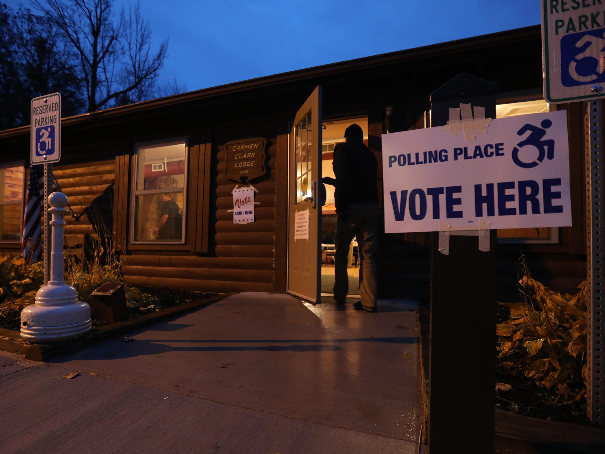 An early morning voter heads into Carmen Clark Lodge in Brighton to vote.