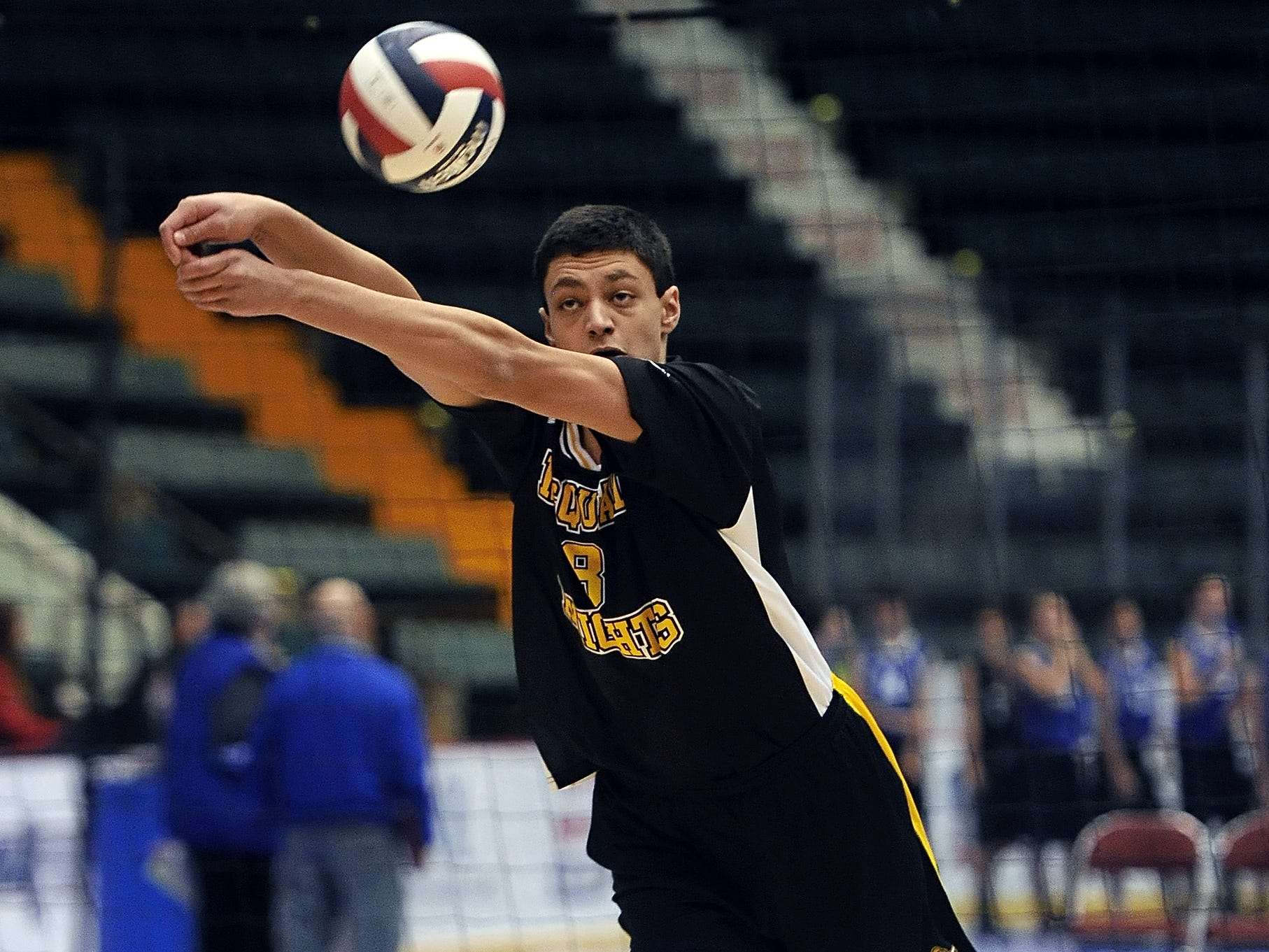 McQuaid's Charlie Siragusa passes the ball towards the net during Division 1 pool play against Bethlehem at the NYSPHSAA Boy's Volleyball Championships held at the Glens Falls Civic Center on Friday, November 11, 2014.  McQuaid beat Bethlehem-II in both games (25-12, 25-19).