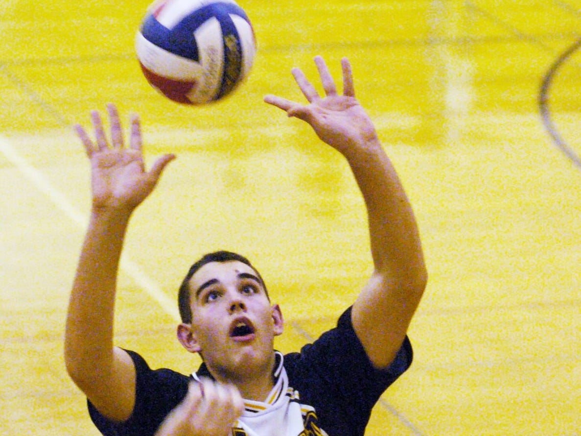 McQuaid's Steve Bintz sets the ball against Churchville-Chili in the semi-final gold medal game of a 2004 tournament at Penfield High School.