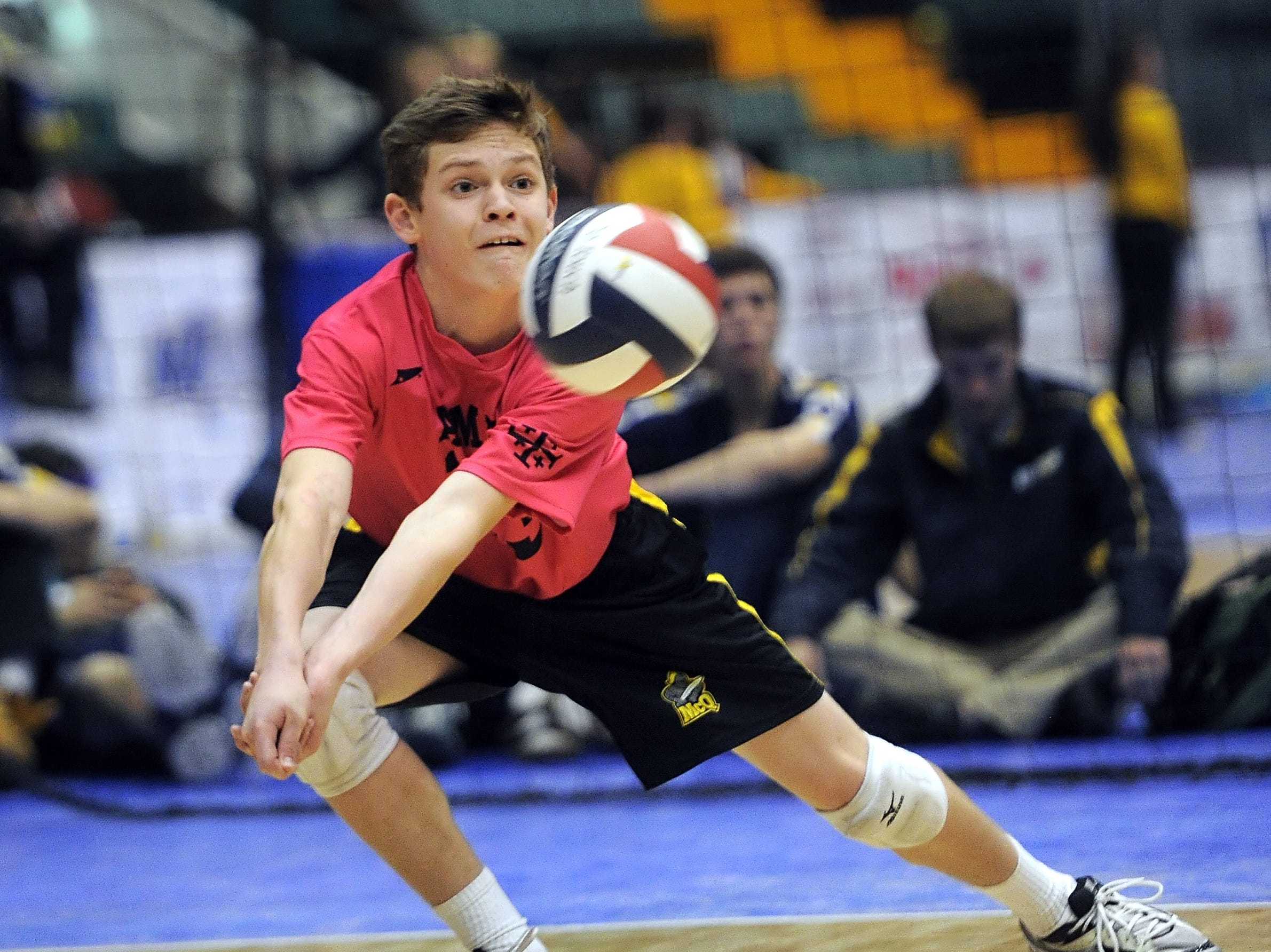 McQuaid's Spencer Wickens stretches to dig a driven ball during the Division 1 final at the NYSPHSAA Boy's Volleyball Championships held at the Glens Falls Civic Center on Friday, November 11, 2014.  McQuaid lost the final to Sachem North-XI in four games (22-25, 22-25, 25-21, 18-25).