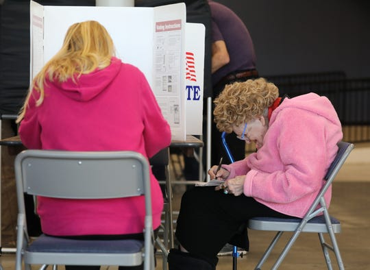 Evelyn Shoots, 94, fills her ballot at the Fair & Expo Center in Henrietta.
