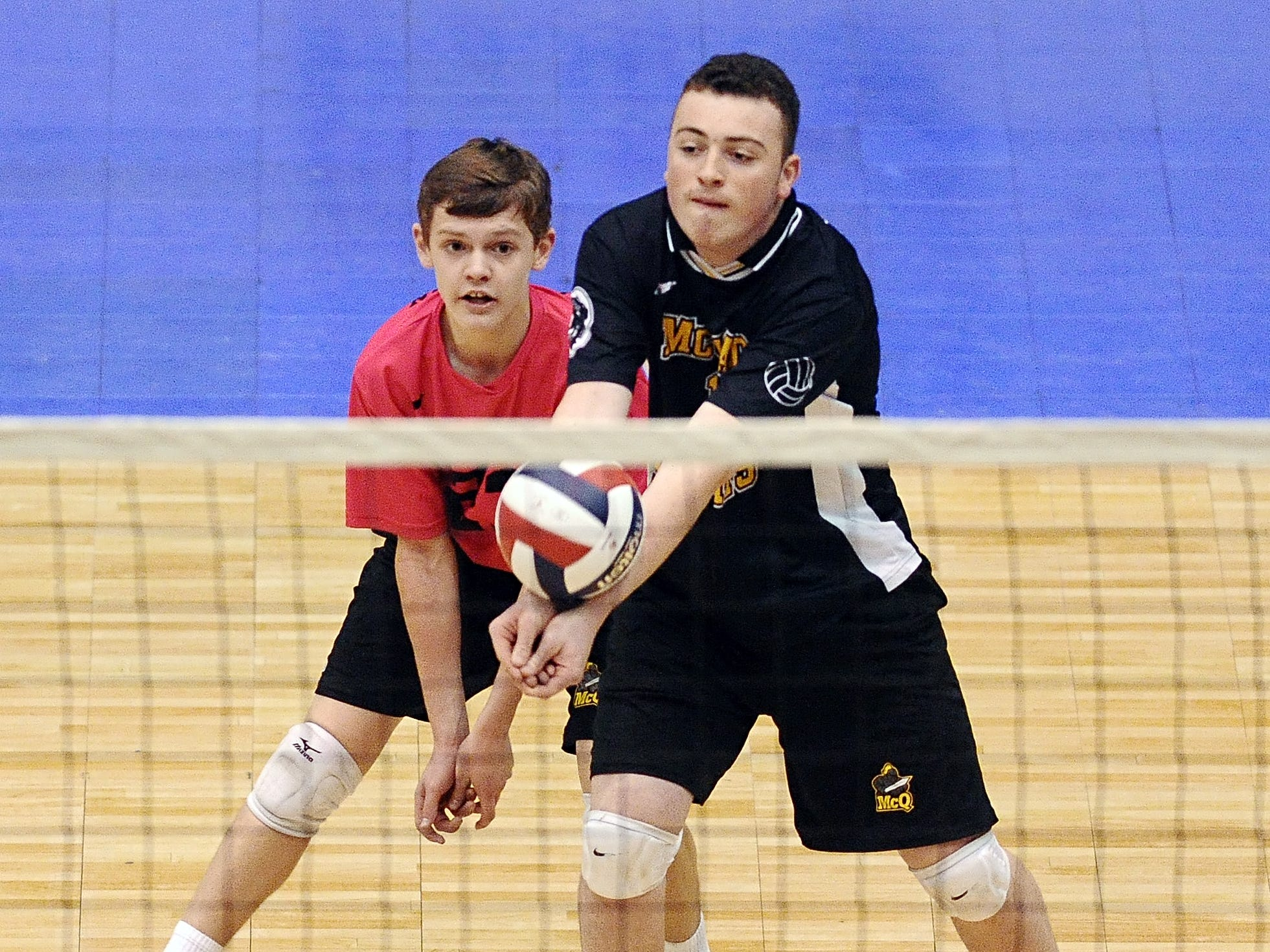 McQuaid's Seamus Darby, front, receives serve against Sachem North during Division 1 pool play at the NYSPHSAA Boy's Volleyball Championships held at the Glens Falls Civic Center on Friday, November 11, 2014.  Sachem North-XI beat McQuaid in both games (25-18, 25-23).