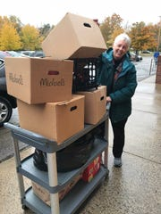 Patricia Fink unloads toy donations at Parkminster Presbyterian Church in Chili, one of three churches who are involved in New Life Toys.