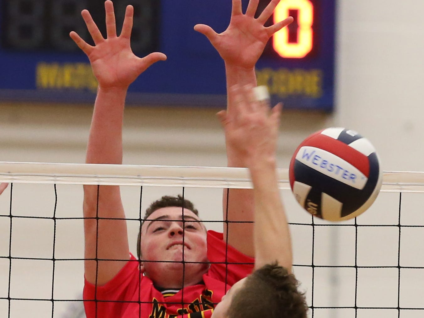 McQuaid's Erik Johnsson blocks a spike at the net by Penfield's Jordan Solomon during their Class A championship matchup Thursday, Nov. 12, 2015 at Webster Schroeder.