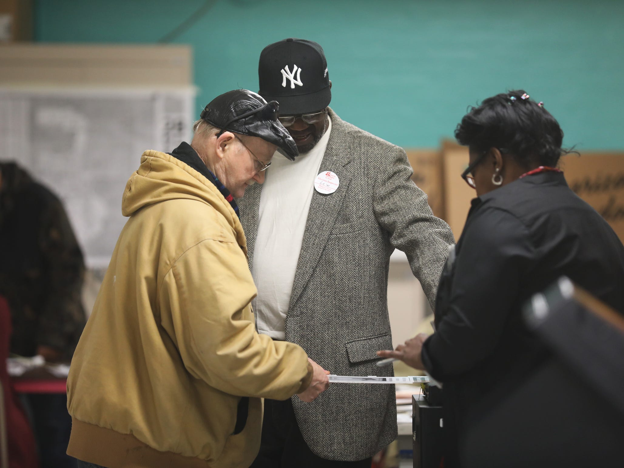 Francis Castle gets help casting his ballot from election inspectors Lem Dawkins and Marilynn Williams at Edgerton Center.