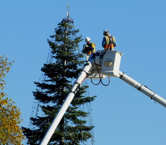 Redding Electric Utility workers set up the community's Christmas tree in downtown Redding on Tuesday, Nov. 6, 2018.