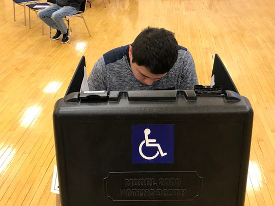 First-time voter Jorge Landeros, 18, cast his ballot Tuesday, Nov. 6, 2018 at Redding Veterans Memorial Hall.