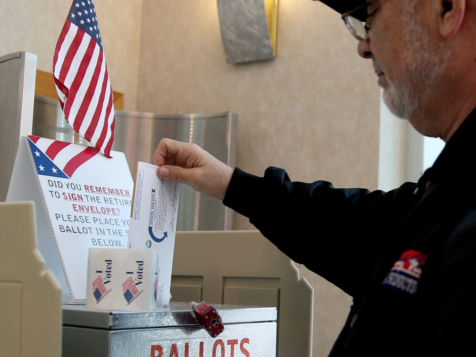 Ed Schoaps, of Salem, drop off ballots to a drop box near the Marion County Elections Office in Salem on Election Day, Tuesday, Nov. 6, 2018.