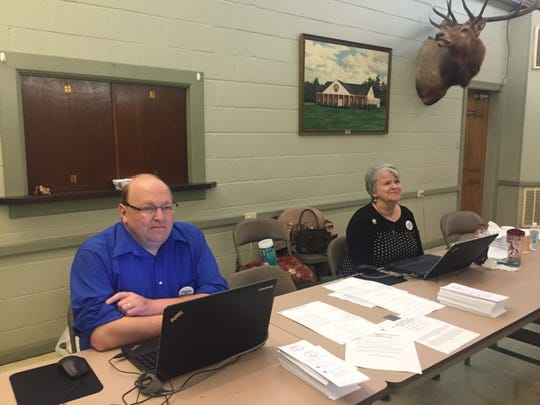 Poll workers Rev. Billy Greer and Karon Eichelberger are ready for a busy day at the polling place at the Elks Lodge in Accomac, Virginia, where more than 10 percent of the precinct's registered voters had cast ballots by 8:30 a.m.