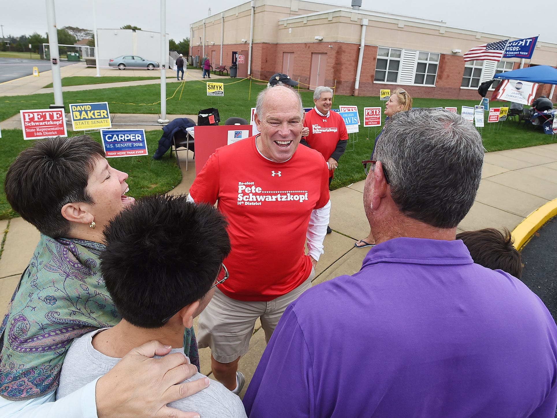 House Speaker Pete Schwartzkopf greets voters at Beacon Middle School near Angola as Voter turnout in eastern Sussex County has been steady at polling places in Rehoboth, Roxana, and Angola as candidates still greet supporters for their support.