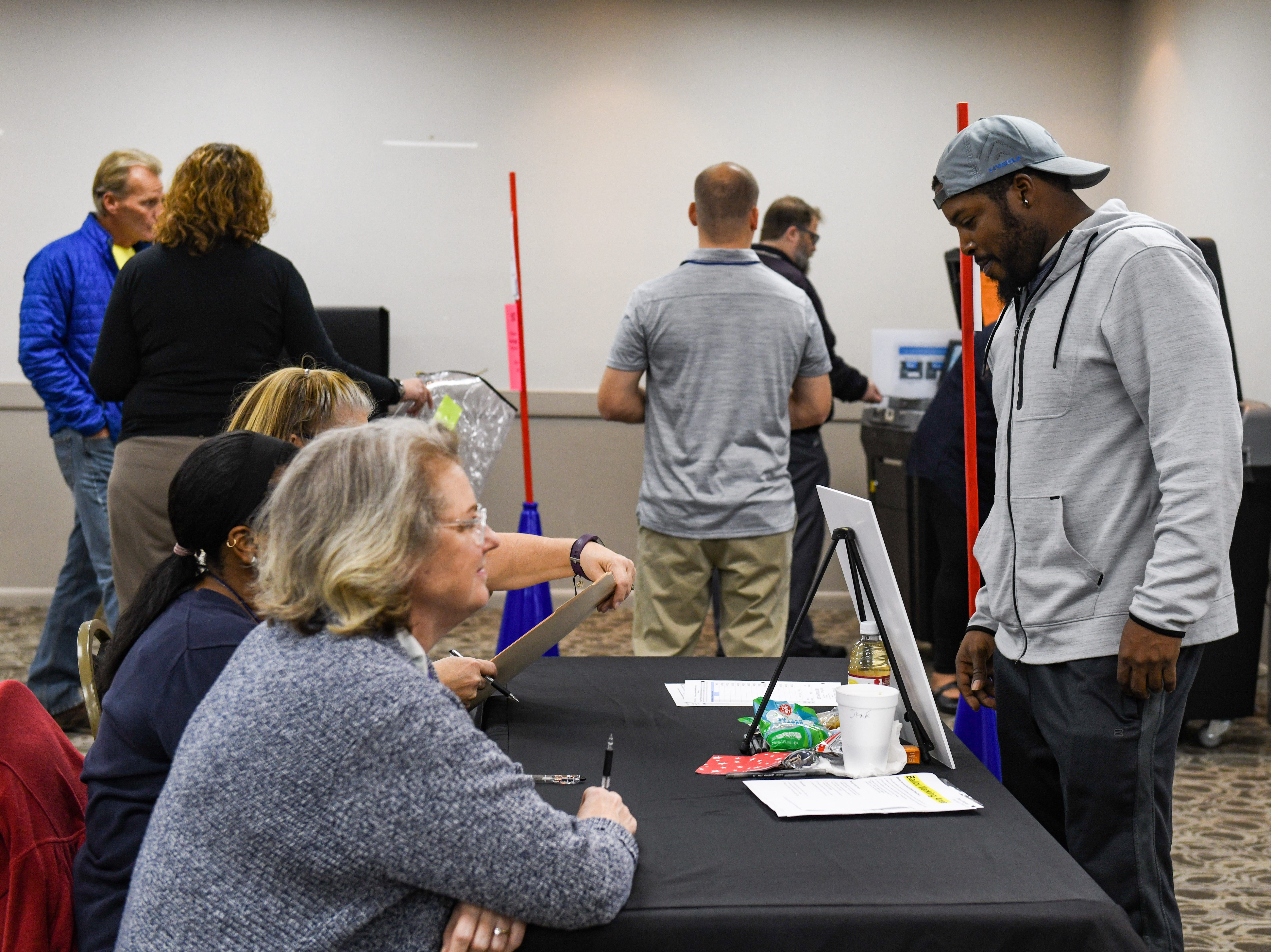 Marquis Waters gets his midterm election ballot at the Wicomico Civic Center on Tuesday, Nov 6, 2018.