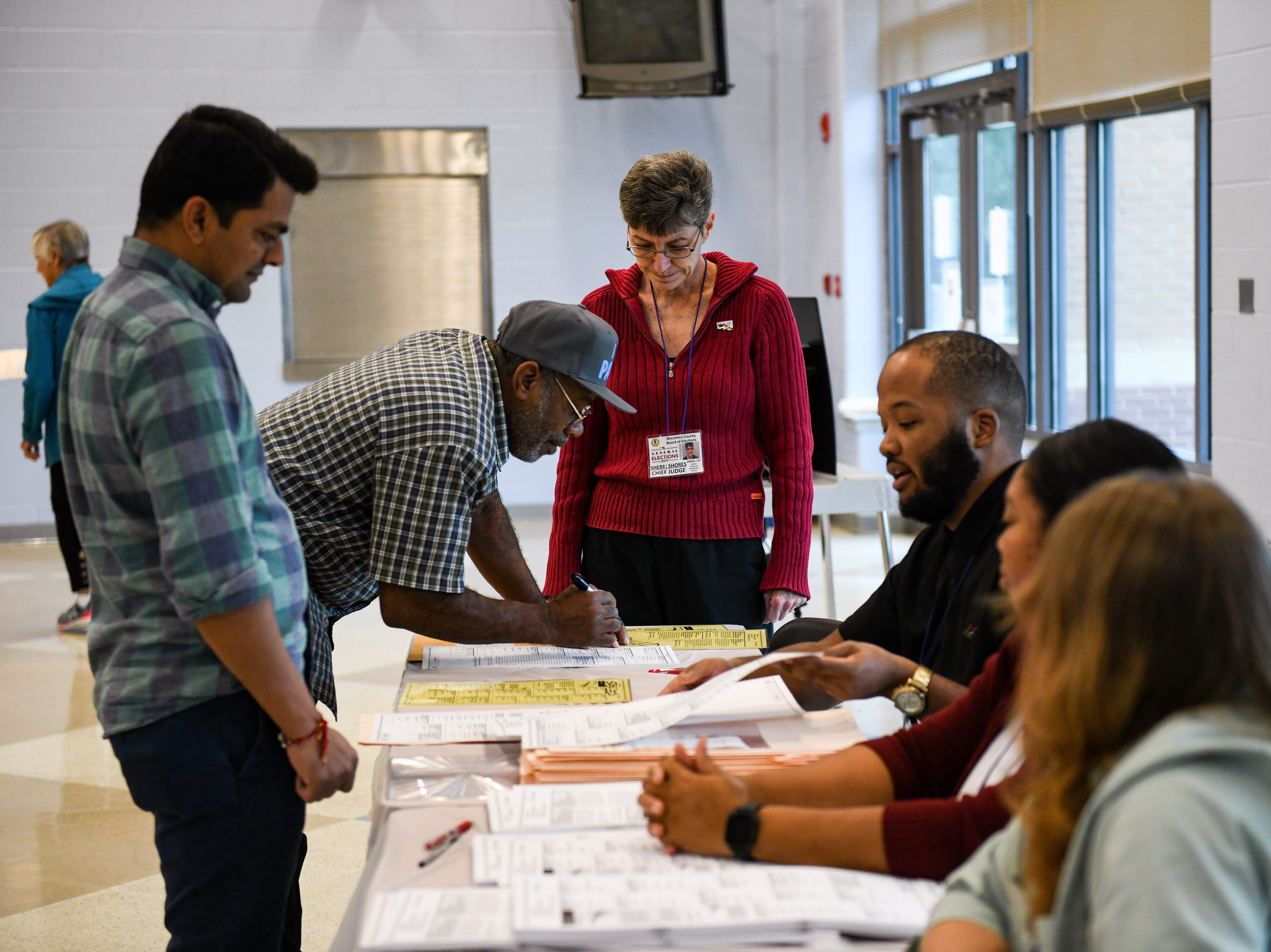 Residents receive their midterm election ballots at North Salisbury Elementary School on Tuesday, Nov 6, 2018.