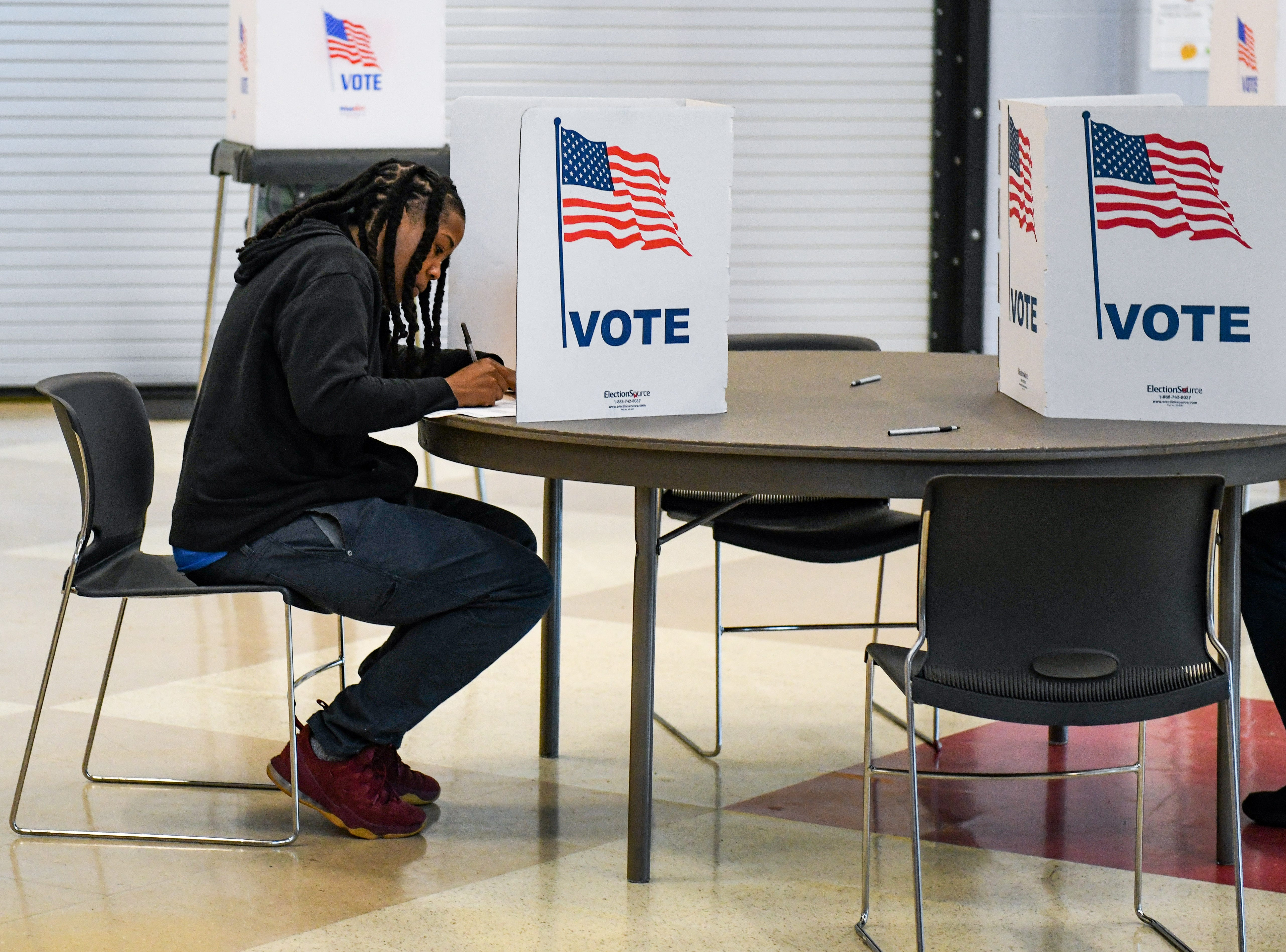 April Gibson votes in the midterm election at North Salisbury Elementary School on Tuesday, Nov 6, 2018.
