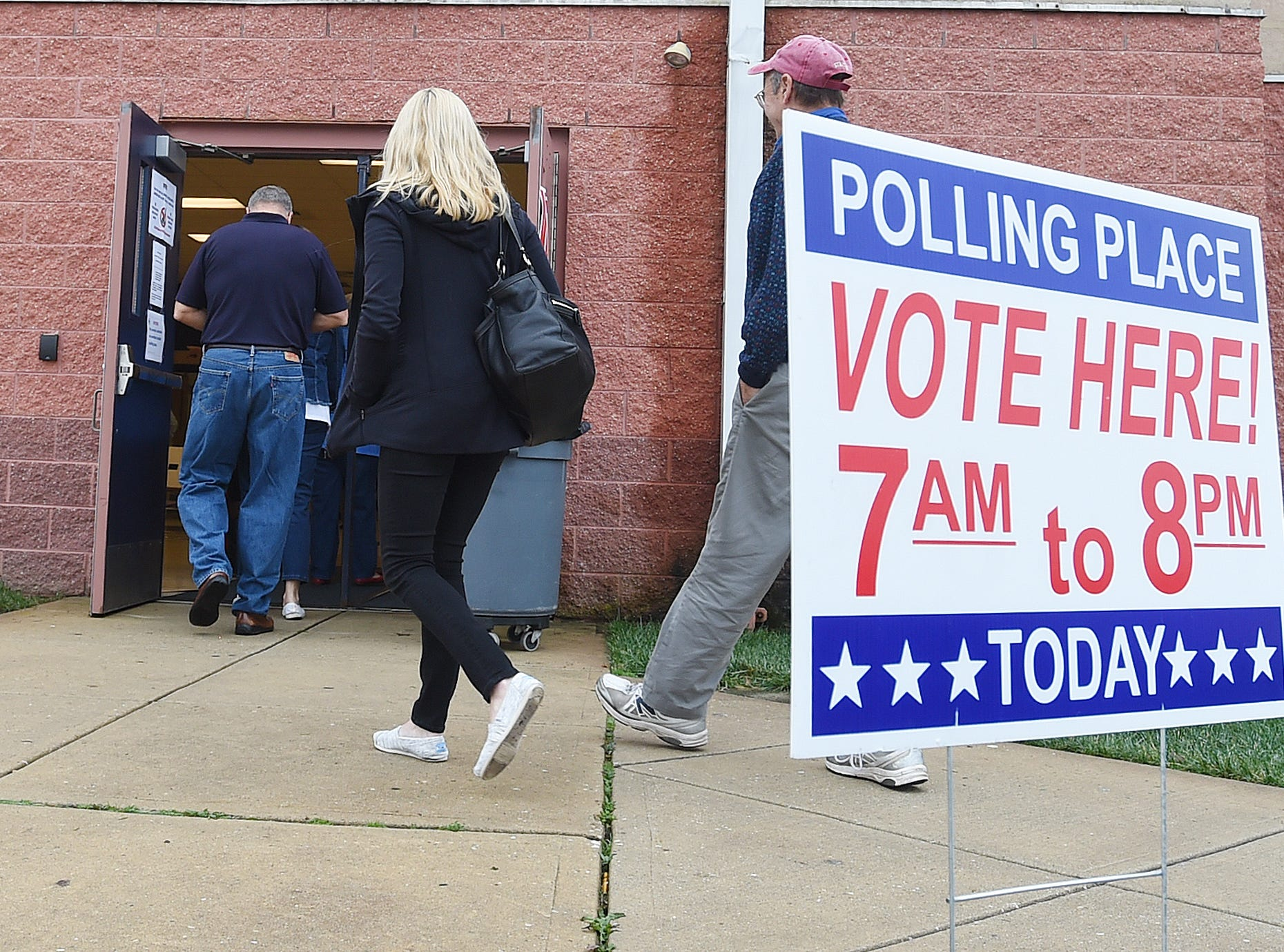 People file into Beacon Middle School near Angola as Voter turnout in eastern Sussex County has been steady at polling places in Rehoboth, Roxana and Angola as candidates still greet supporters for their support.