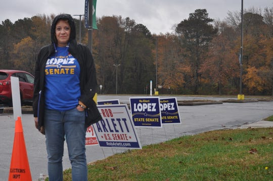 Restaurant owner Cheryl Tilton stands outside a polling place in Georgetown in support of state Sen. Ernie Lopez, R-Lewes, who is up for re-election, on Nov. 6, 2018.