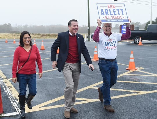 U.S. Senate Candidate Rob Arlett with wife Lorna arrives to vote at the Roxana Fire Station as voter turnout in eastern Sussex County has been steady at polling places in Rehoboth, Roxana, and Angola as candidates still greet supporters for their support.