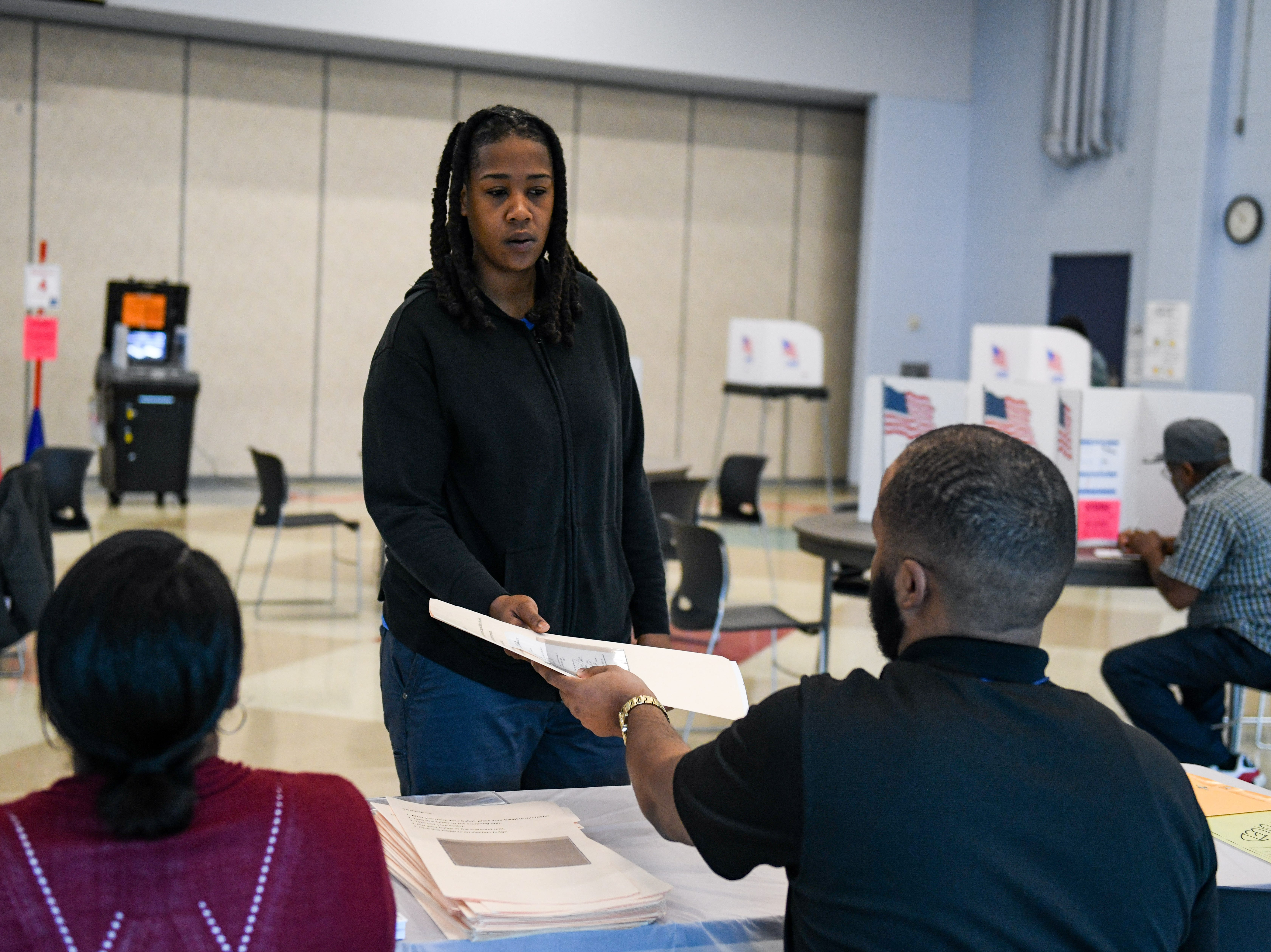 April Gibson gets a midterm election ballot at North Salisbury Elementary School on Tuesday, Nov 6, 2018.