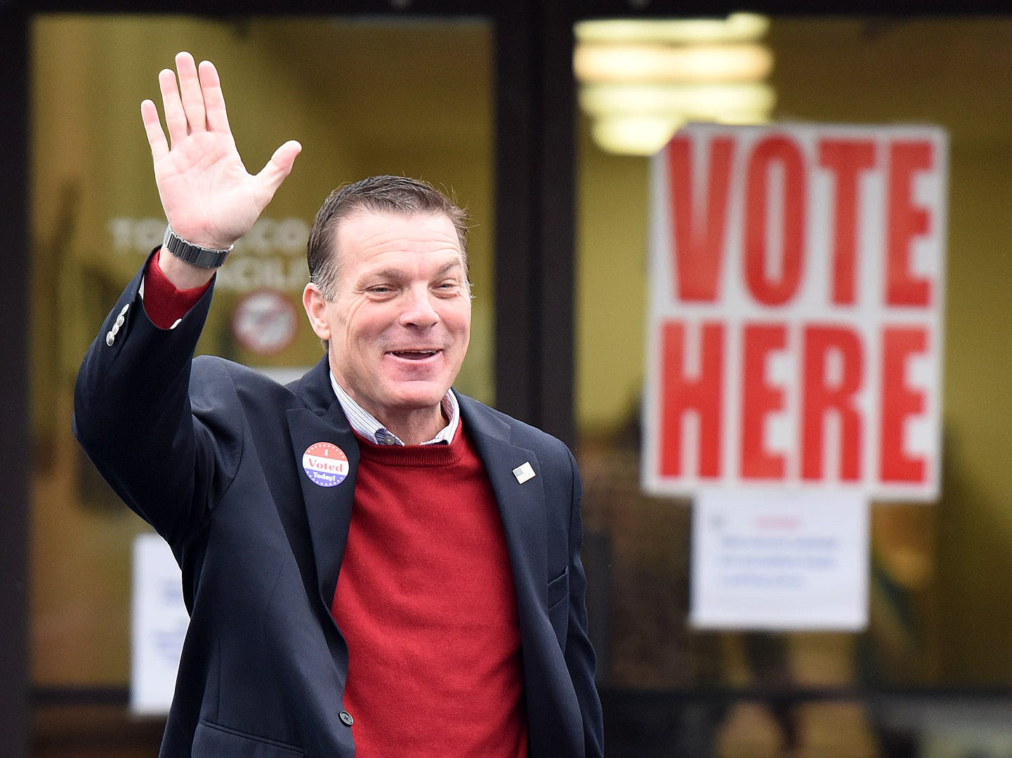 U.S. Senate candidate Rob Arlett waves after voting at Roxana Fire Station as Voter turnout in eastern Sussex County has been steady at polling places in Rehoboth, Roxana, and Angola as candidates still greet supporters for their support.