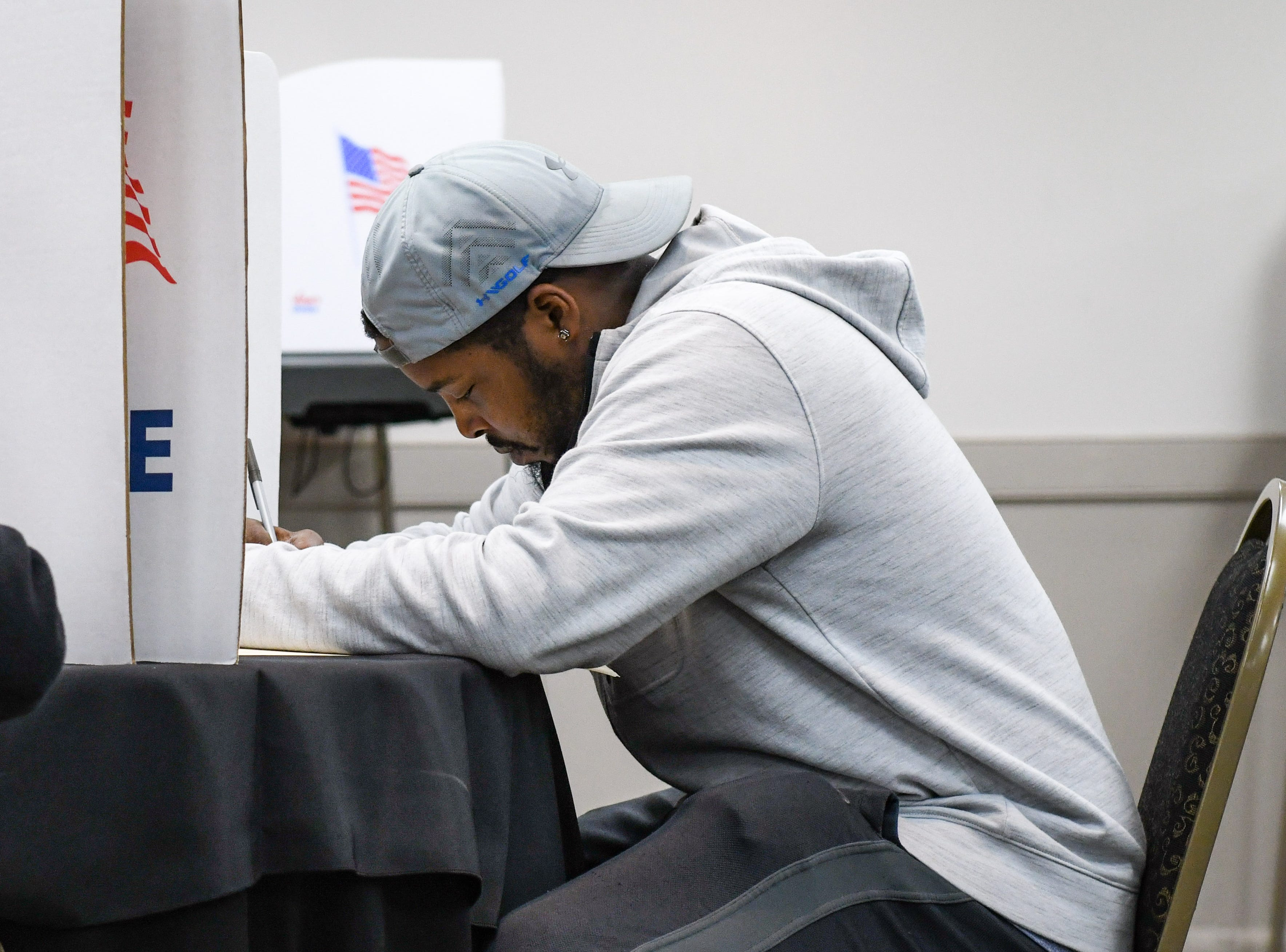 Marquis Waters (right) votes in the midterm election at the Wicomico Civic Center on Tuesday, Nov 6, 2018.