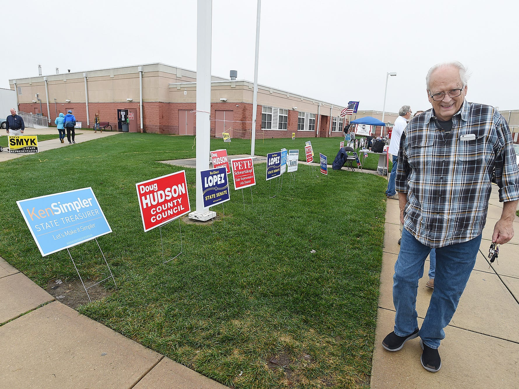 People come to vote at Beacon Middle School near Angola as Voter turnout in eastern Sussex County has been steady at polling places in Rehoboth, Roxana and Angola as candidates still greet supporters for their support.