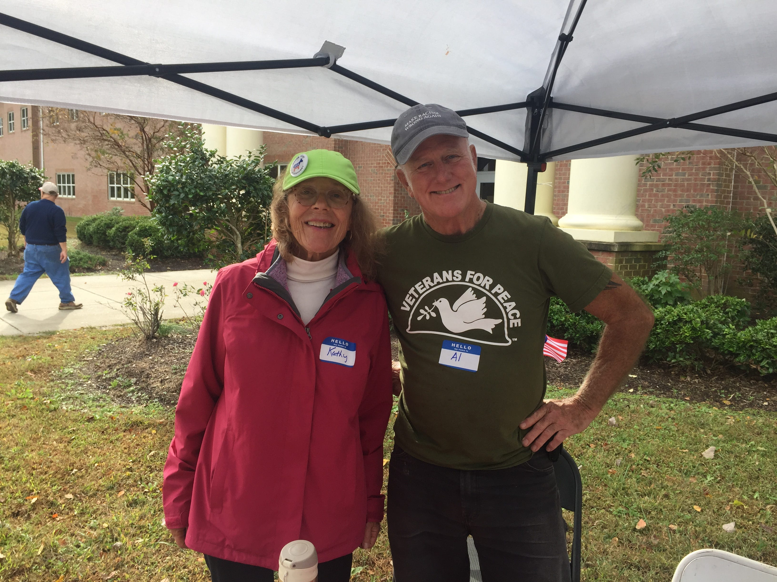 Volunteers Kathy Boyd and Al McKegg stand at the  Democratic candidates table outside the polling place at Nandua Middle School in Onley, Virginia on Election Day, Tuesday, Nov. 6, 2018.