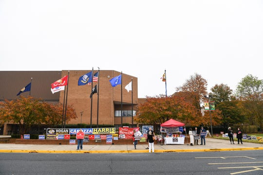 Campaigners and signs outside the Wicomico Civic Center on Tuesday, Nov 6, 2018.