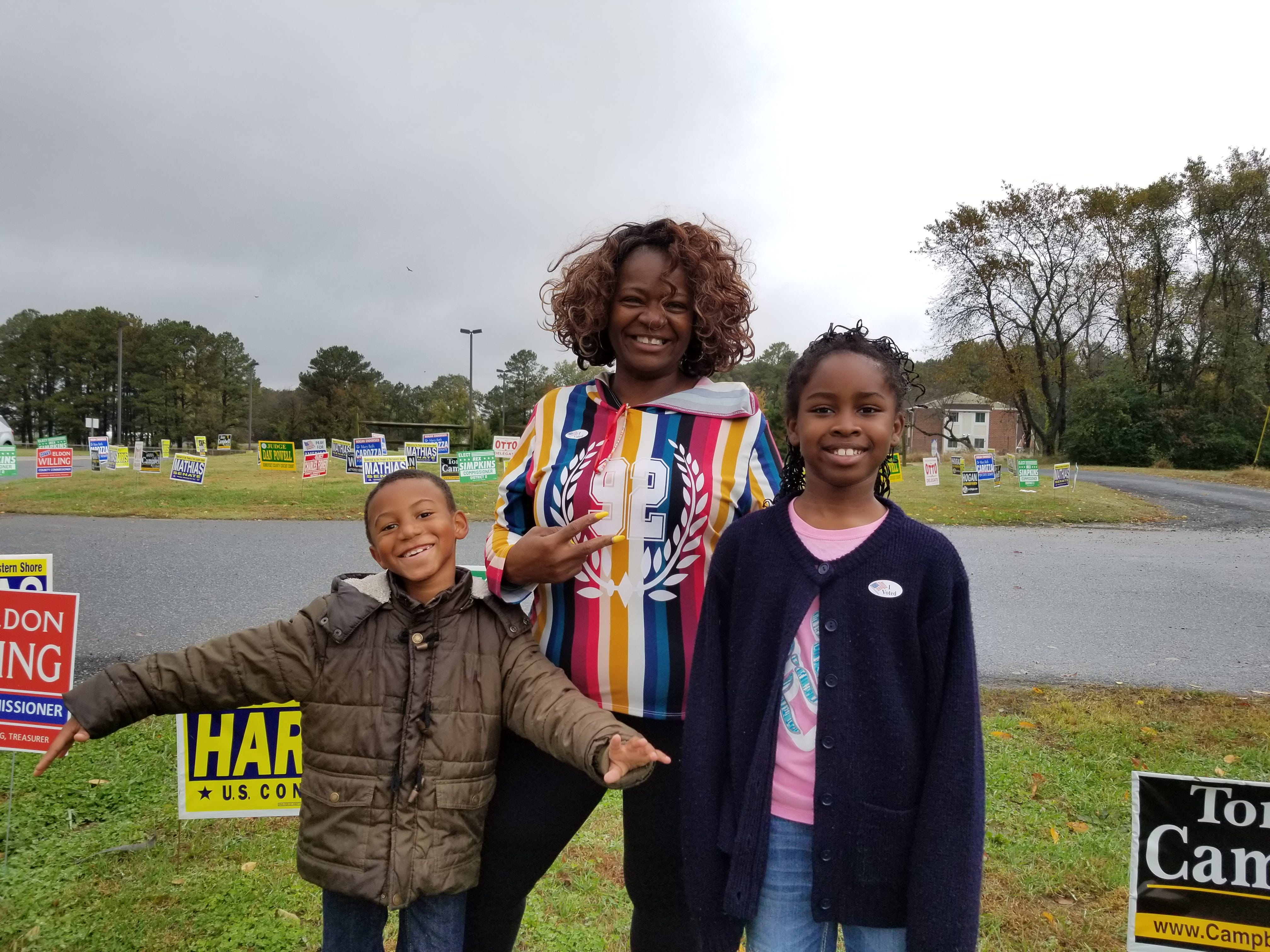 Valentina Downing of Princes sAnne brought her grandchildren, Adyahnn Burrell, 6, and Naomi Sell, 9, with her to the polls at Greenwood Intermediate School.