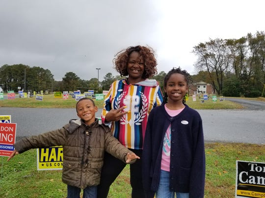 Valentina Downing of Princess Anne brought her grandchildren, Adyahnn Burrell, 6, and Naomi Sells, 9, with her to the polls at Greenwood Intermediate School.