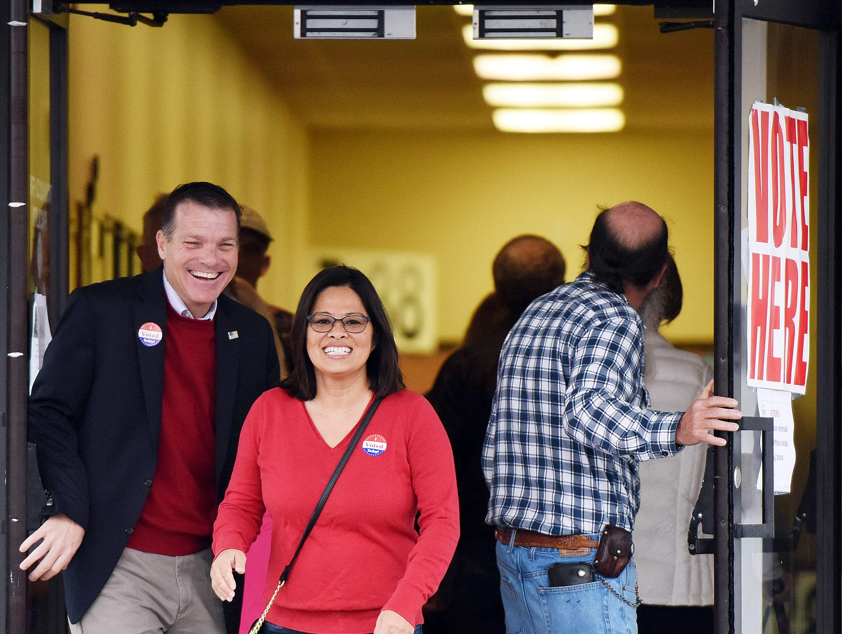 U.S. Senate Candidate Rob Arlett and wife Lorna exit after voting at the Roxana Fire Station as voter turnout in eastern Sussex County has been steady at polling places in Rehoboth, Roxana, and Angola as candidates still greet supporters for their support.