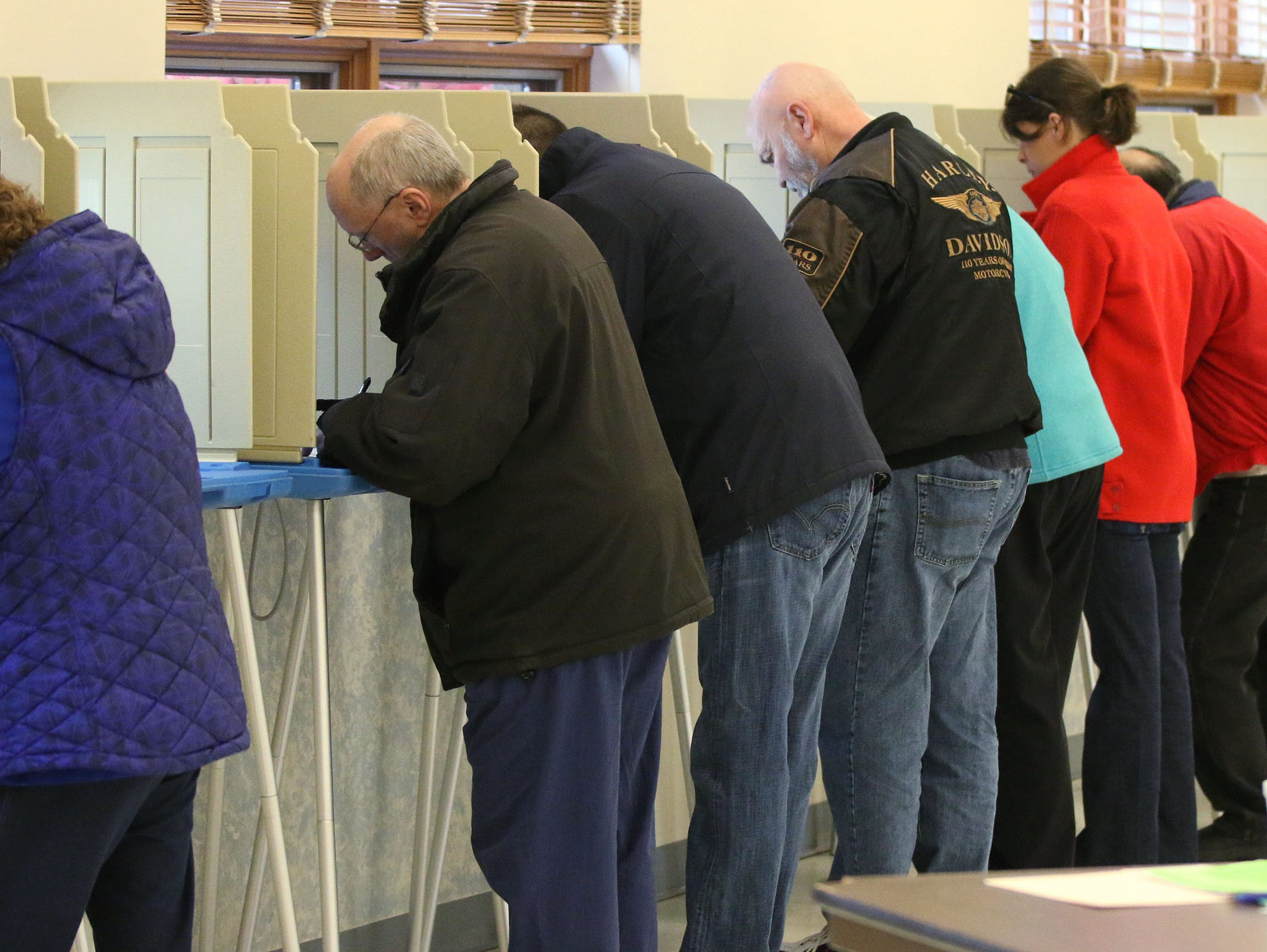 People fill ballot stations at Good Shepard Lutheran Church, Tuesday, November 6, 2018, in Sheboygan, Wis.