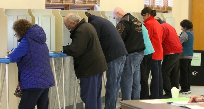 People fill ballot stations at Good Shepard Lutheran Church, Tuesday, November 6, 2018, in Sheboygan, Wis.