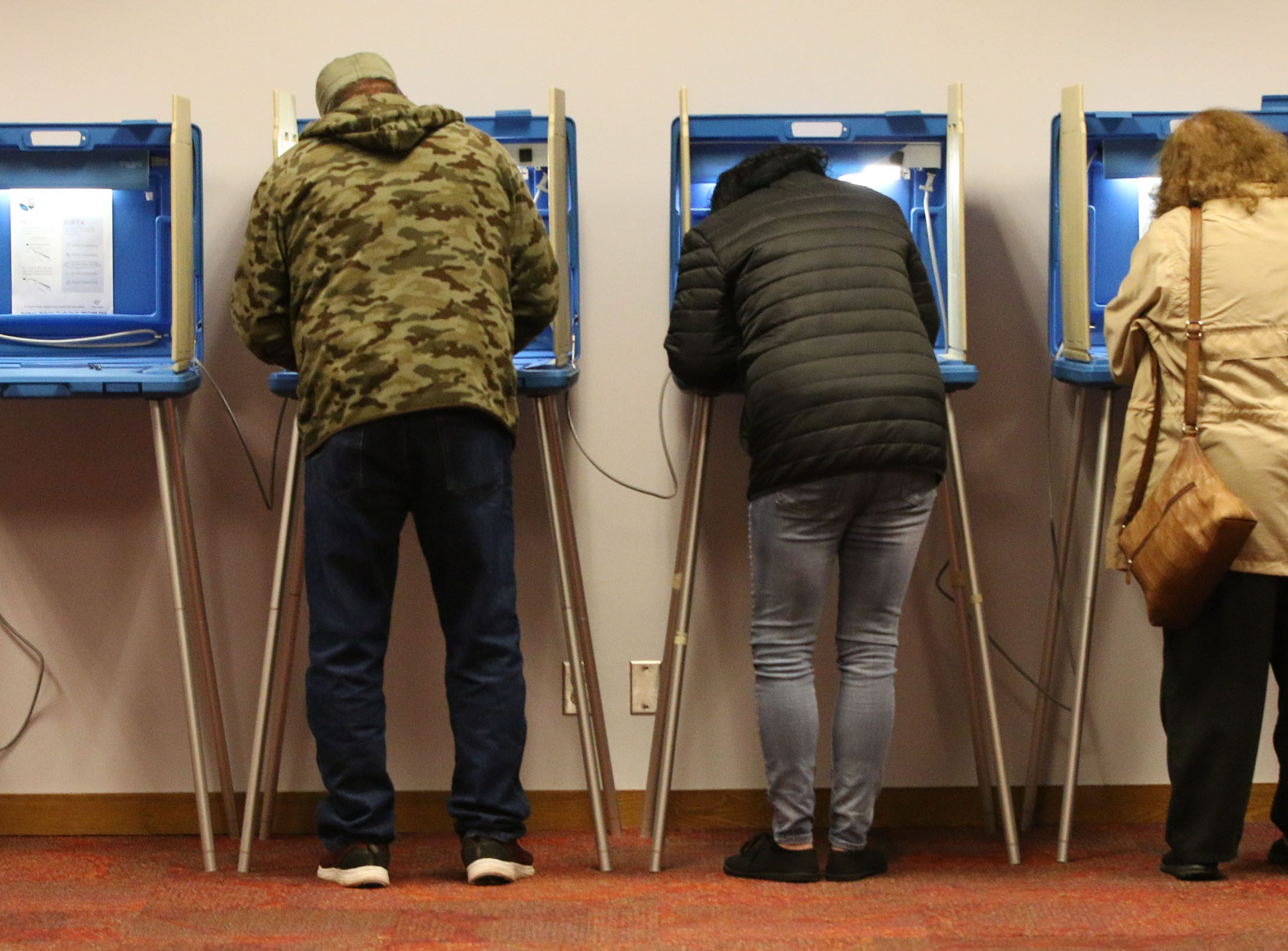 Voters cast their ballots at Mead Public Library poll, Tuesday, November 6, 2018, in Sheboygan, Wis.
