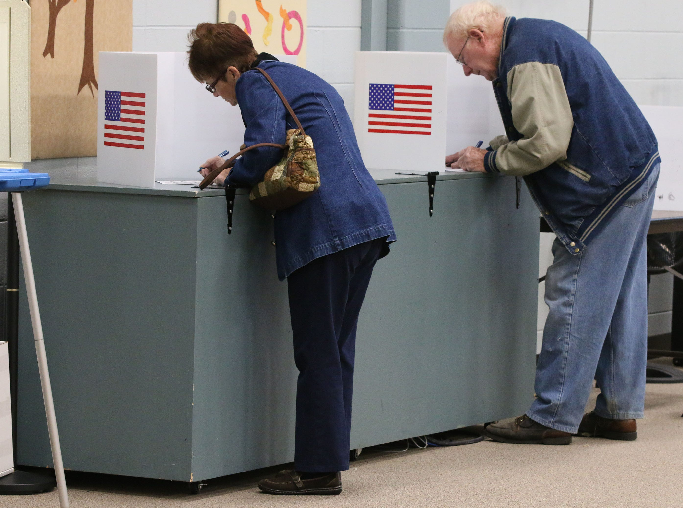 People work on filing out their ballots for the midterm election at Bethany Reformed Church, Tuesday, November 6, 2018, in Sheboygan, Wis.