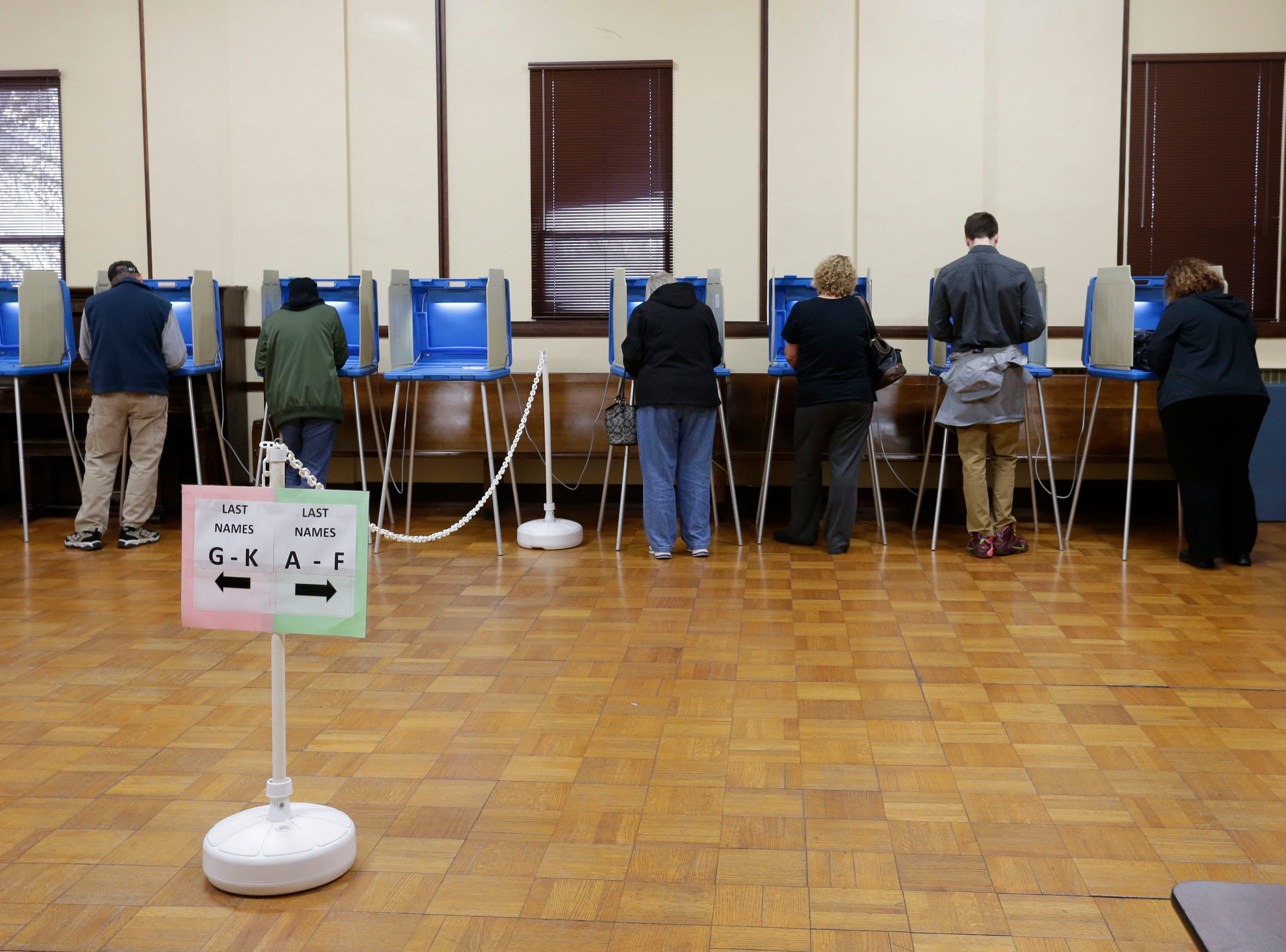 Voters at the polls at Plymouth City Hall, Tuesday, November 6, 2018, in Plymouth, Wis.
