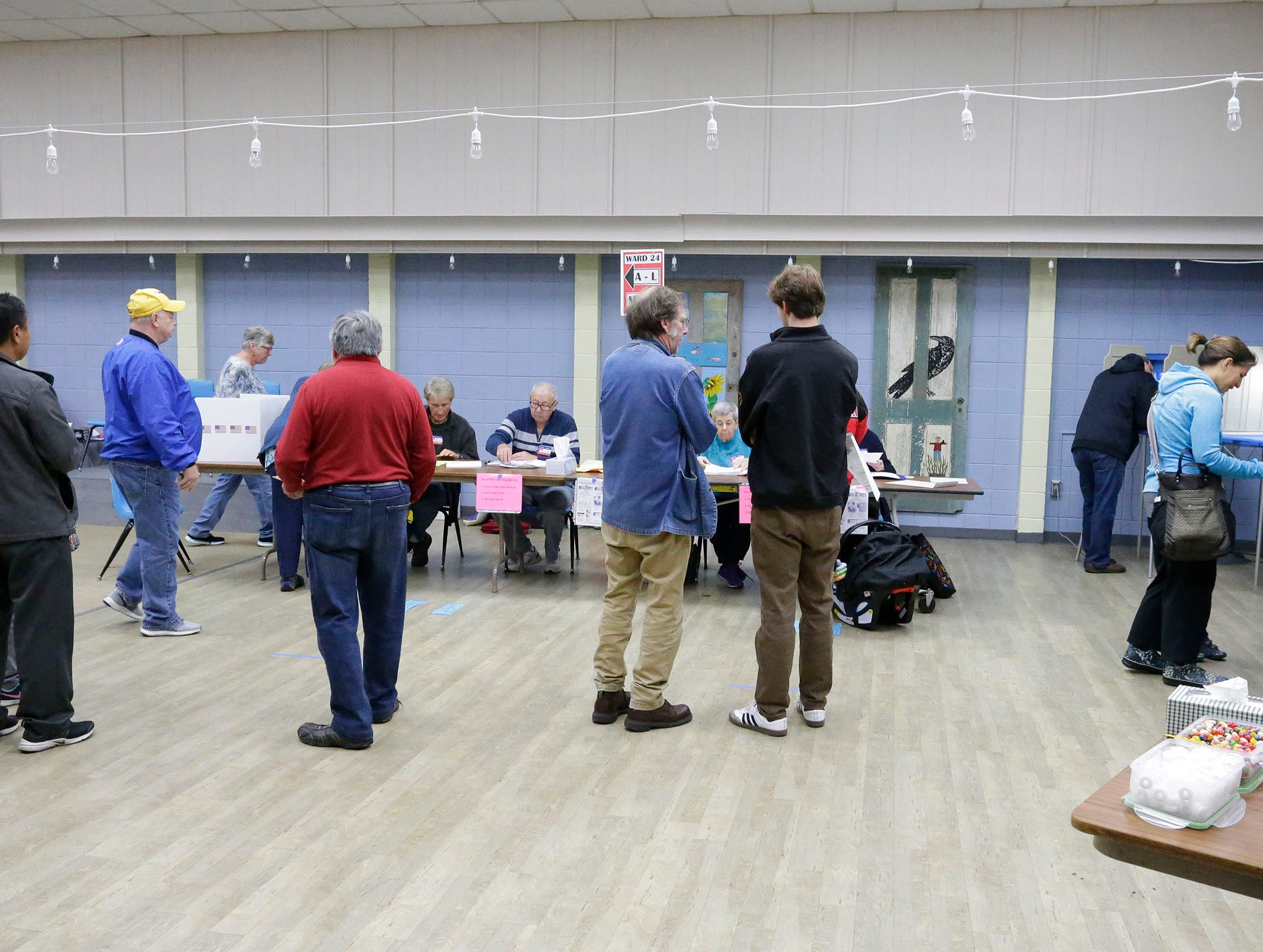 People wait to vote at the Senior Activity Center poll, Tuesday, November 6, 2018, in Sheboygan, Wis.