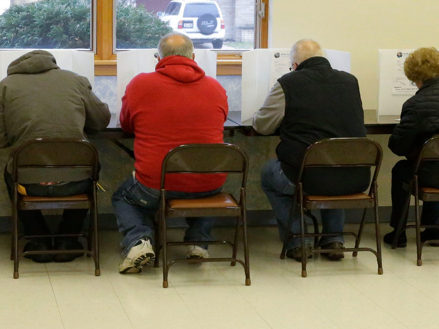 Space was limited at a table of ballot stations at Good Shepard Lutheran Church, Tuesday, November 6, 2018, in Sheboygan, Wis.