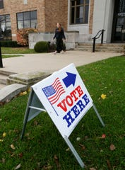 Signs indicate where the voting entrance is to Plymouth City Hall, Tuesday, November 6, 2018, in Plymouth, Wis.