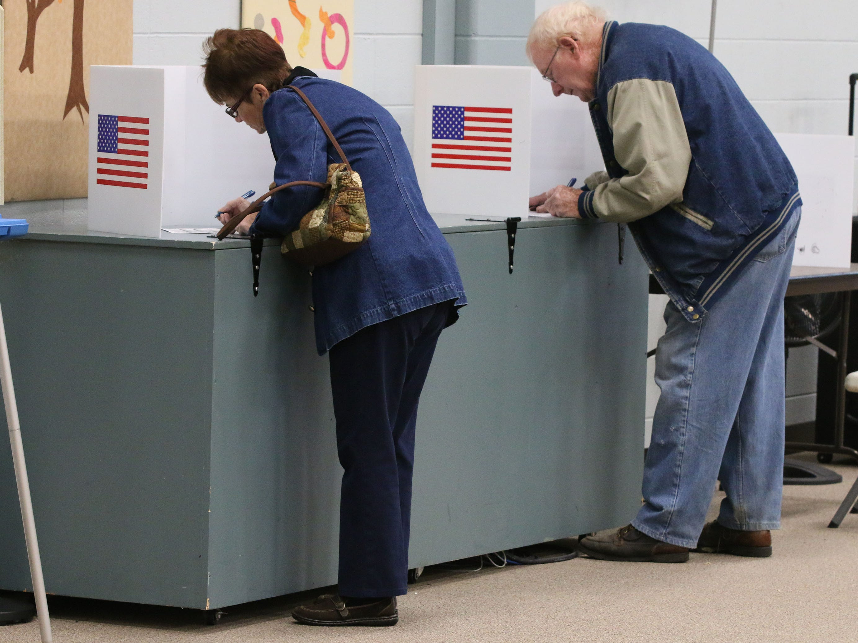 Voters cast their ballots at Bethany Reformed Church, Tuesday, November 6, 2018, in Sheboygan, Wis.