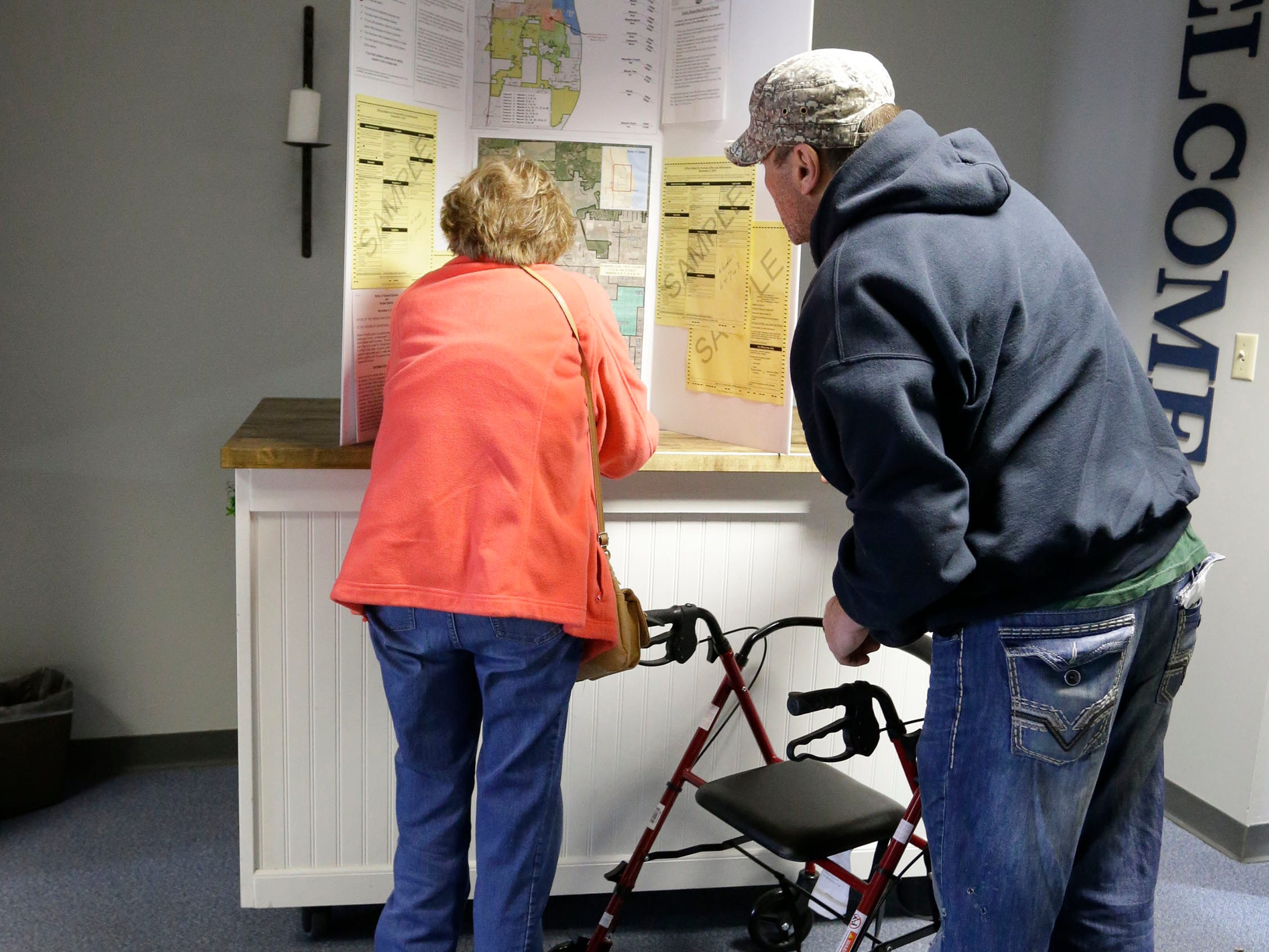 Voters inspect a ward map at Evangelical Free Church polls, Tuesday, November 6, 2018, in Sheboygan, Wis.
