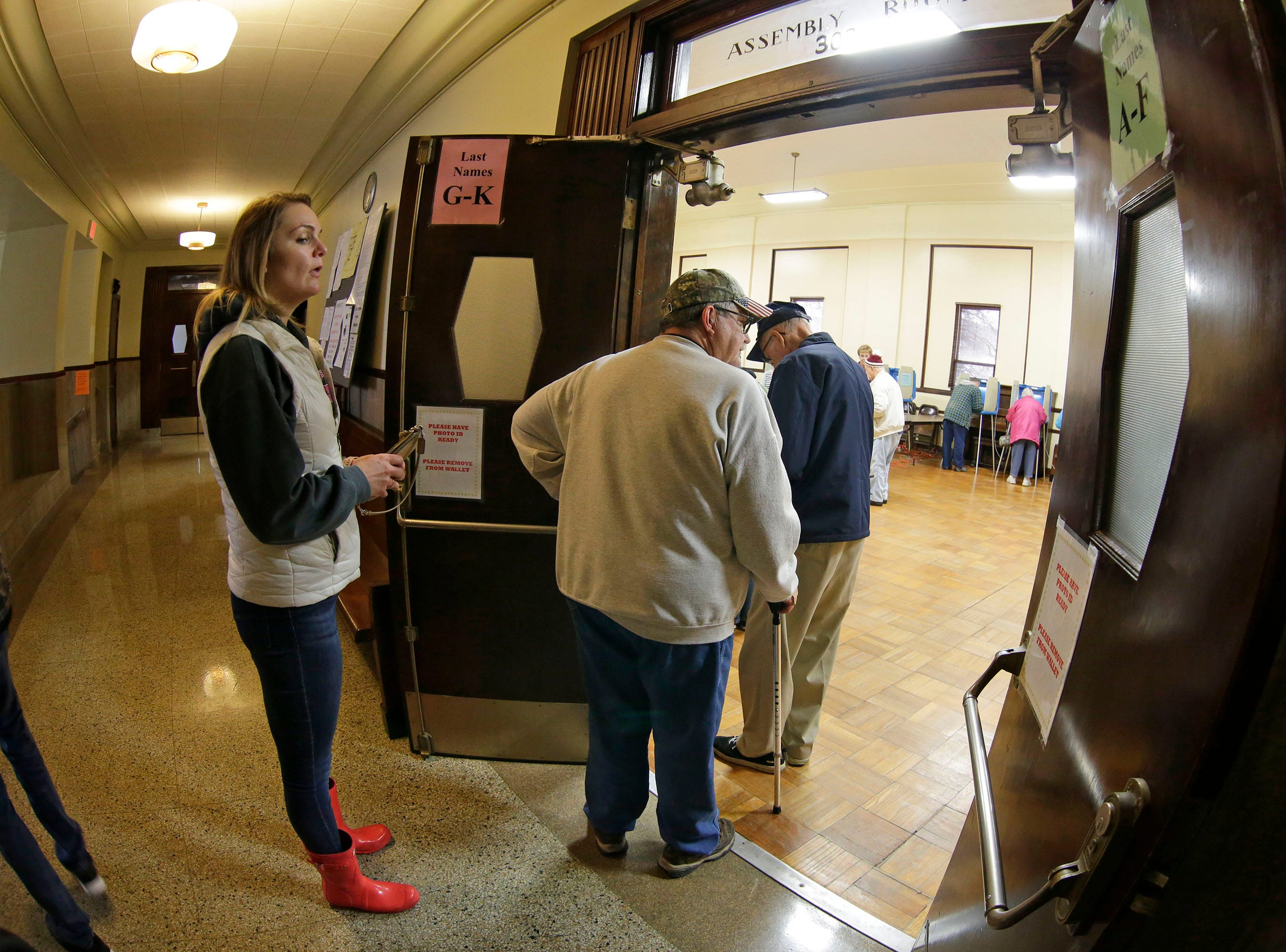 Voters enter the voting area at Plymouth City Hall, Tuesday, November 6, 2018, in Plymouth, Wis.