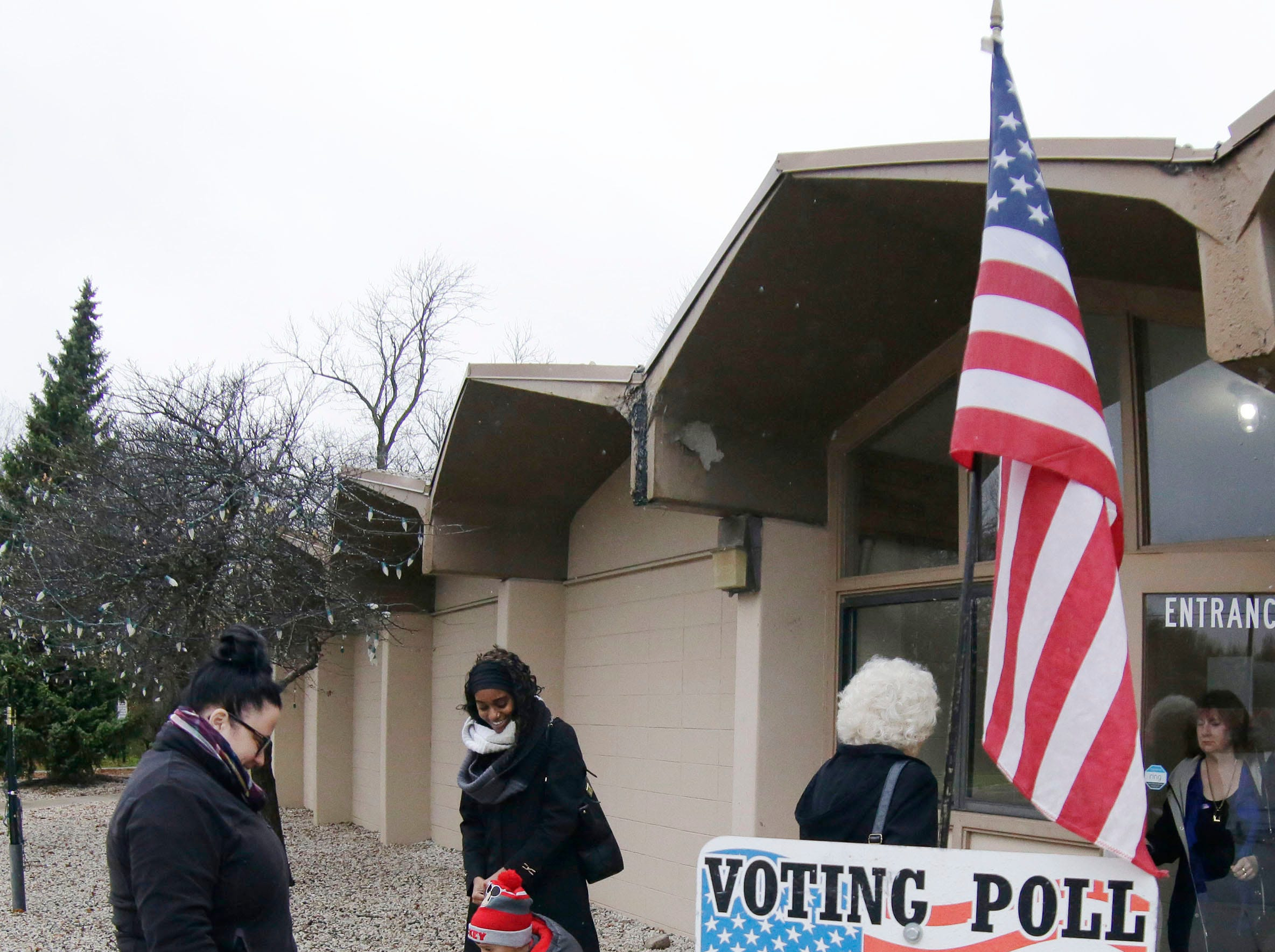 Voters exit and arrive at the Quarryview Center polling place, Tuesday, November 6, 2018, in Sheboygan, Wis.